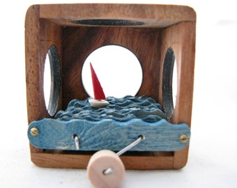 kinetic nautical art, wood sailboat automaton sculpture, small wooden puzzle box
