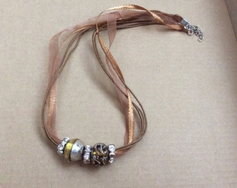 Brown organza ribbon necklace with slider beads