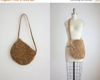 VACATION SALE. woven jute shoulder bag