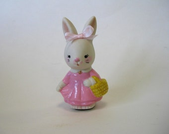 "Porcelain 3"" handcrafted bunny carrying a basket"