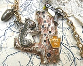 a squirrels nuts necklace assemblage pendant fall acorn upcycle