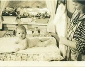 1920s Baby on Kitchen Table After Bath With Grandma Holding a Towel  Vintage Black and White Photo Photograph