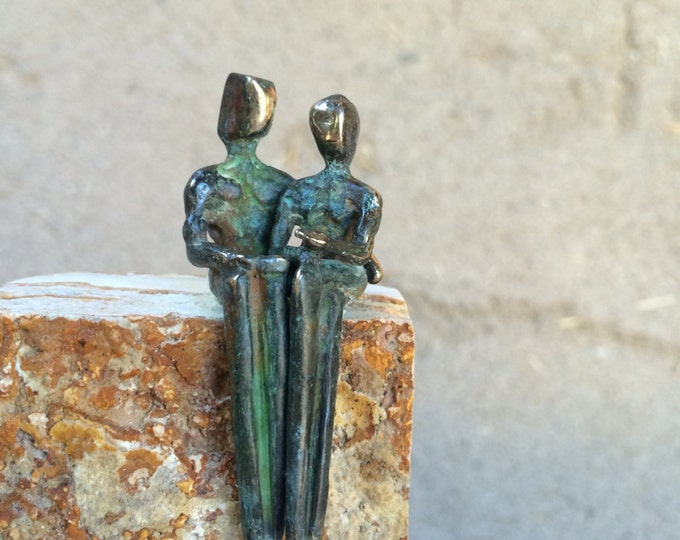 PETITE BRONZE LOVERS >> Romantic miniature bronze sculpture made in Santa Fe, New Mexico by Yenny Cocq Mounted on rustic travertine or onyx