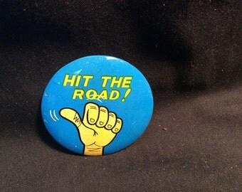 Japanese Tin Litho joke/statement pinback button - Hit The Road - 1960s