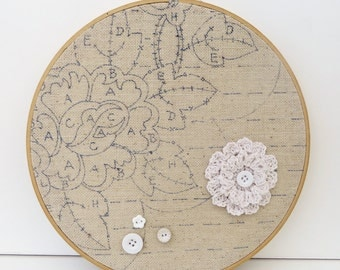 floral embroidery hoop art with vintage buttons and crochet flower
