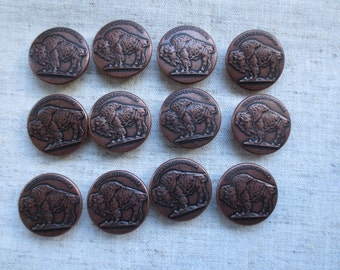 Vintage beautiful antique brass tone buffalo design metal shank button. Lot of 48.