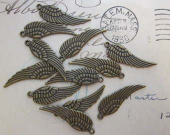 12 wing charms - antiqued brass finish - 9mm x 27mm