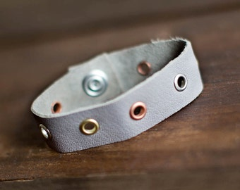 Grey leather cuff bracelet with eyelets