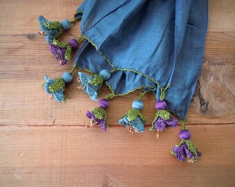 blue scarf with large blue and purple crochet flowers