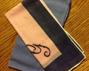 Two vintage handkerchiefs, purples and pink.