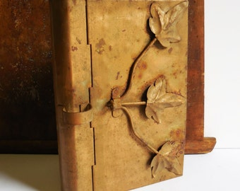 Vintage metal book box container Decorative leaves embellishments storage hammered metal safe hollow book cover