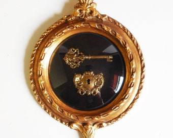 Framed key and plate Ornate gold frame circle bubble glass Baroque decorative Koi Fish Forest face man skeleton key