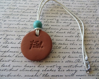Essential Oil Diffusing Aromatherapy Leather Necklace with Blue Wood Bead and Faith Terra Cotta Pendant