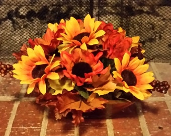 Sunflower and fall leaves arrangement in amber vase