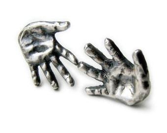 silver miniature hands titanium or niobium earrings
