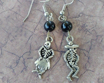 Day of the dead dancing skeletons man a woman couple earrings