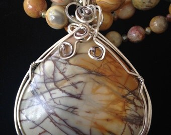 Brecciated jasper wrapped in sterling silver