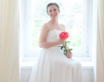 Ecru chiffon wedding dress with fitted corset