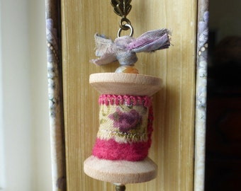 Wooden Spool Pendant, ruby red felt, fabric on spool, spool to wear