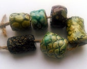 The clear body of spring -- a set of 7 rustic green, brown, turquoise  ceramic art beads