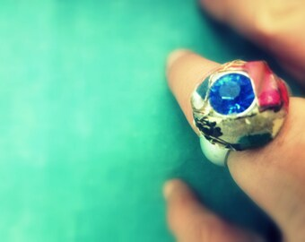blue stone and paper ring