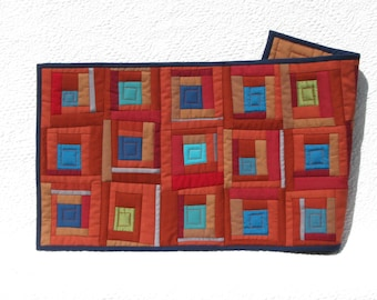 Rusty reds and aqua blues table runner, modern quilted wall art