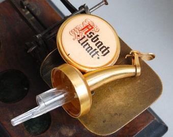 Vintage metal and plastic brandy bottle stopper, Asbach Uralt