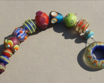 Handmade lampwork glass beads in bright colors by Flamejewels
