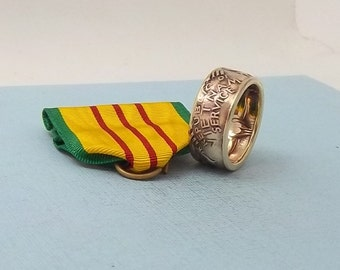 For the Vietnam Vet.  This is a Vietnam service medal turned into a size 10  ring.