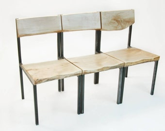 Set of three Plum Chairs in live-edge Silverleaf maple and waxed steel.