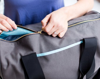Gym weekender duffel bag in black grey aqua blue by Maltby