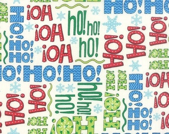 on SALE thru 8/1 HO HO Ho red green blue words on  snow white cotton print by the 1/2 yard Moda fabric Christmas 19701-15