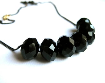 Simple long necklace with jet black large crystal beads, black and gold colored chain