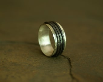 sterling silver fidget ring with hammered and oxidized spinners