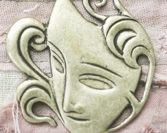 Fancy Venetian mask brass stamping with flourishes, brass ox