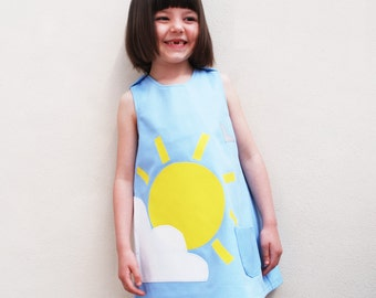 Girls dress handmade with summer sunshine and cloud