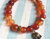 Handmade Red Agate Bracelet with Antiqued Gold  Skull and Gold Industrial Beads.