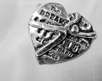 Ernest Hemingway Quote on Silver Heart Pendant. Original Design by Judy Reno. approx. 1 inch, We become strong in the broken places.