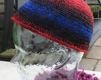 Crochet beanie skullcap hat in variegated red, black and blue yarn