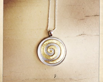Mixed metal silver plated/brass spiral, music lyric necklace.
