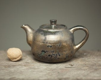small bronze  gold glazed teapot