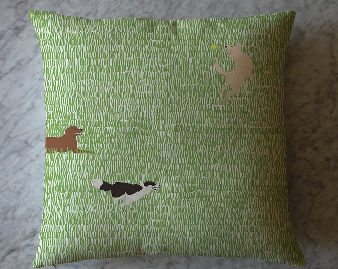 Pillow with Dogs in Grass.  July 15, 2014