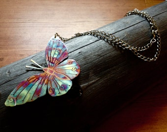 Butterfly necklace made from burnt copper