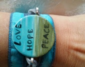 Valentines day gift teal silk wrap braclet with ceramic center for the hip chick.
