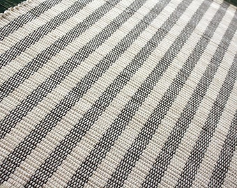 Handwoven cotton rug-cream and charcoal stripe