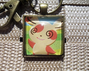 Spinda Glass Pendant made from Trading Cards