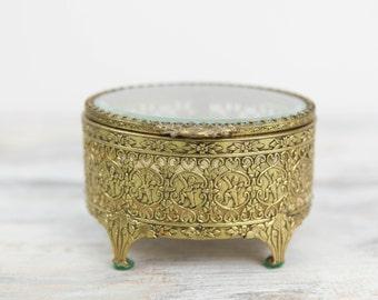 Vintage Gold Plated filagree trinket box w/ bevel glass lid. (see Item Details for full description)