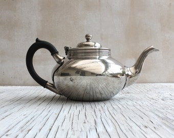 Vintage silver plated teapot with decorative bakelite handle. Made by Cooper Brothers & Sons, England.