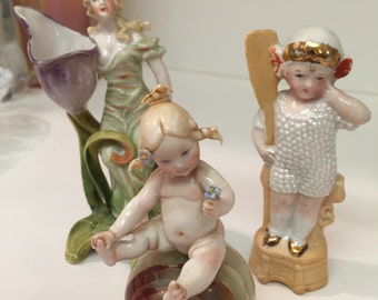Three Piece Porcelain Art Nouveau figurines baby on Alabastor, Art Deco girl w/ paddle