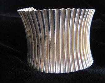 vintage cuff bracelet of ribbed brass by Parklane, 1960's